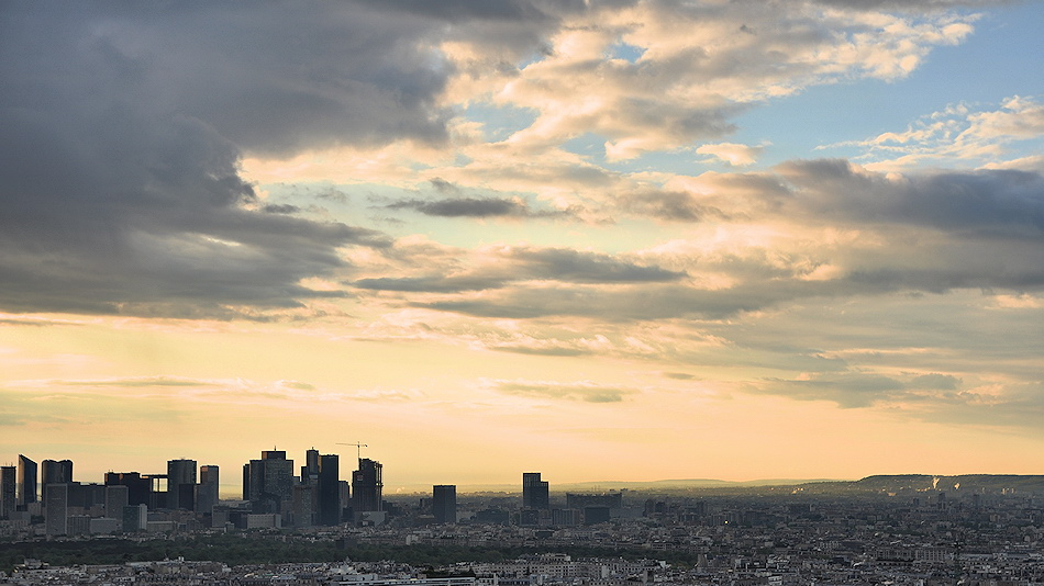 beautiful sky sun coming back at La defense view from eiffel tower